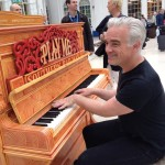 Loz playing the piano on the station concourse