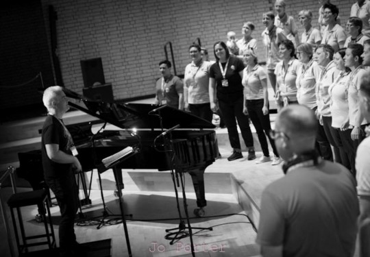 The choir rehearsing for Hand in Hand